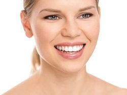 A blonde woman with a bright white smile