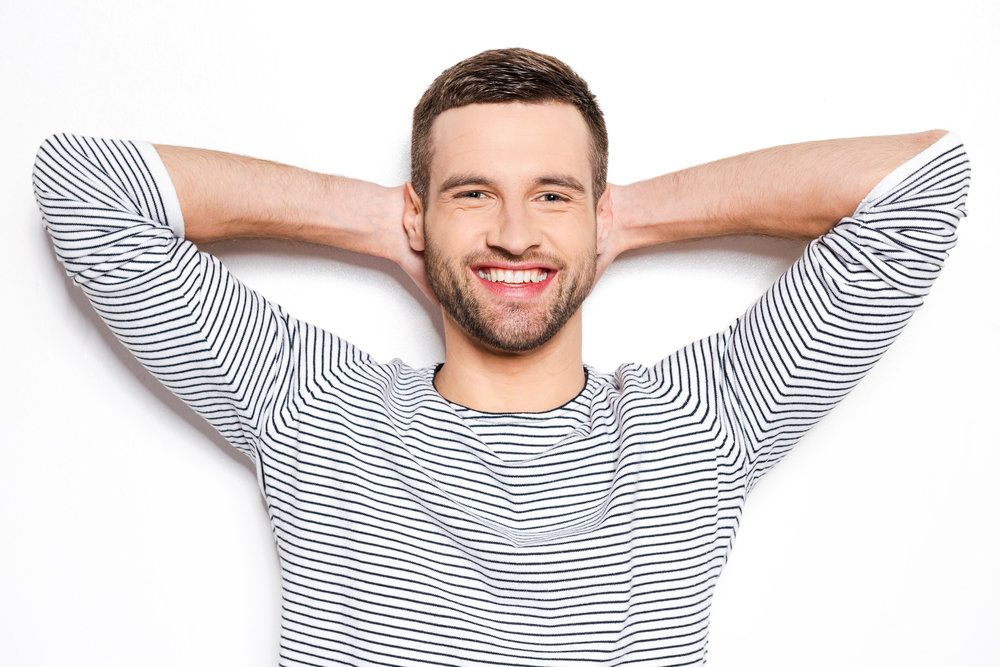 A man in a striped shirt smiling