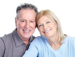 Senior couple with healthy smiles