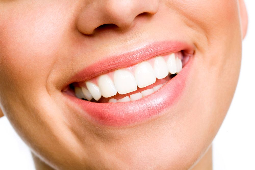 A close-up of a woman's bright, white, healthy smile