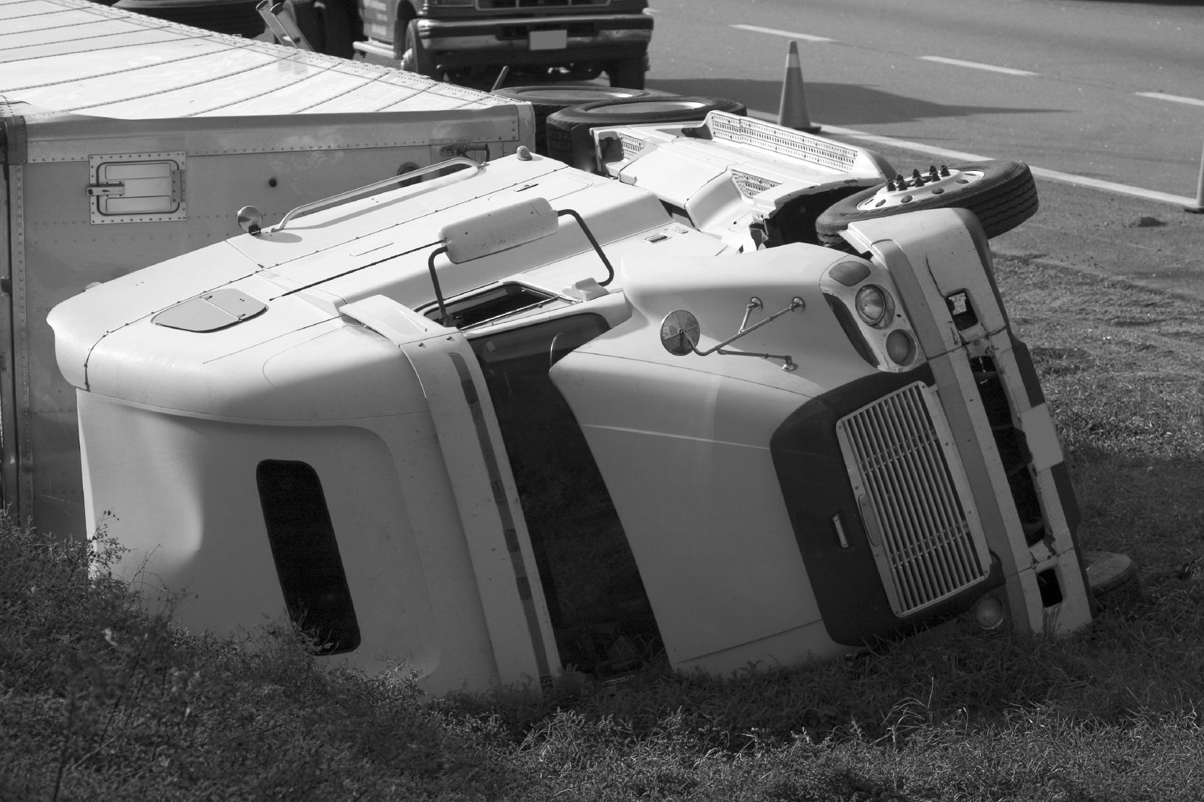 black and white photo of an overturned semi truck