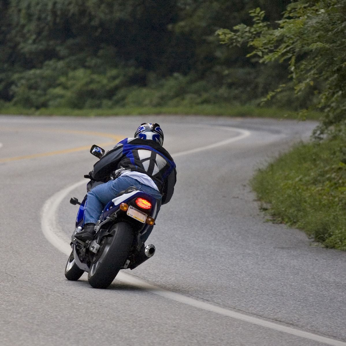 A motorcyclist on a winding road