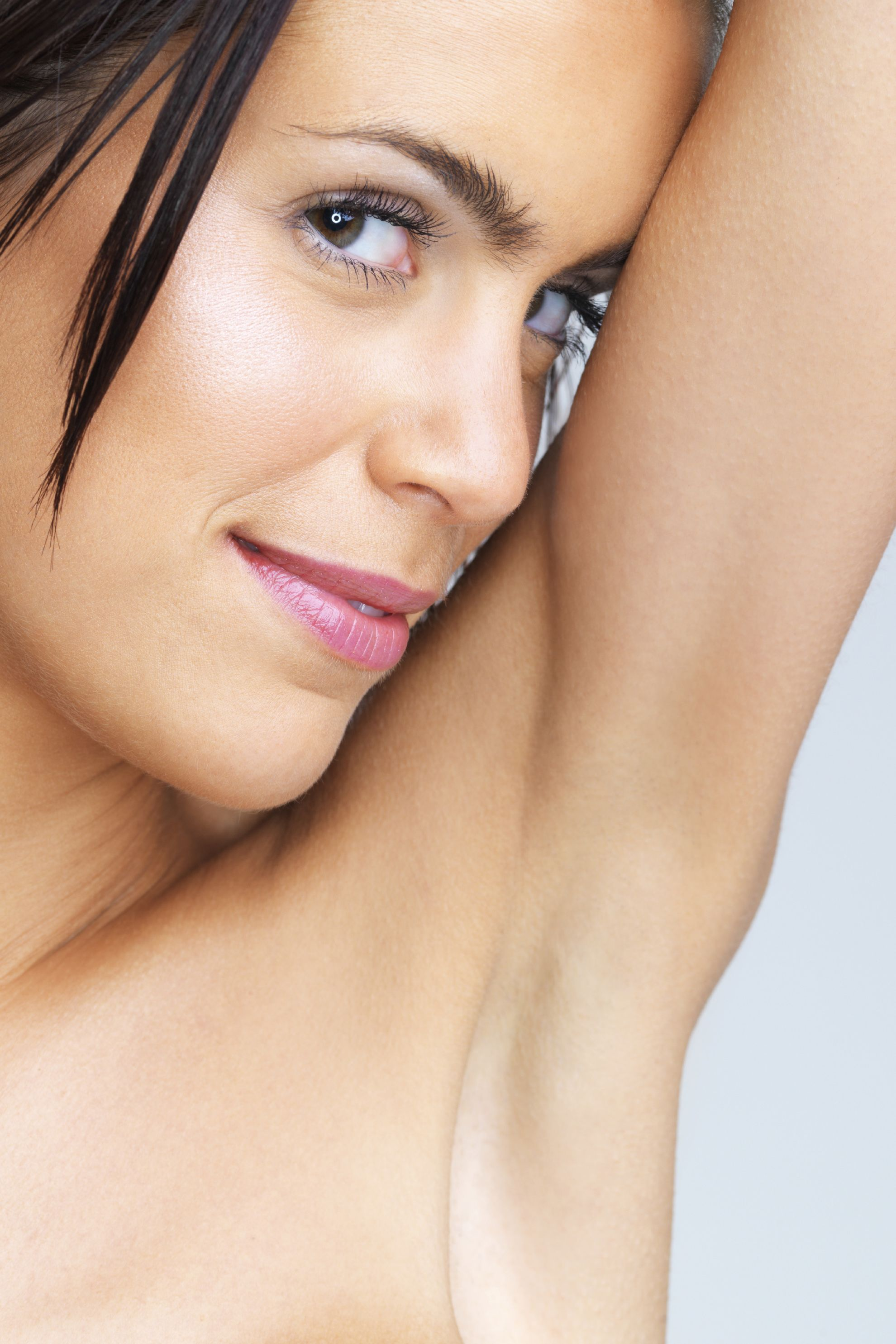 A woman with hairless underarms