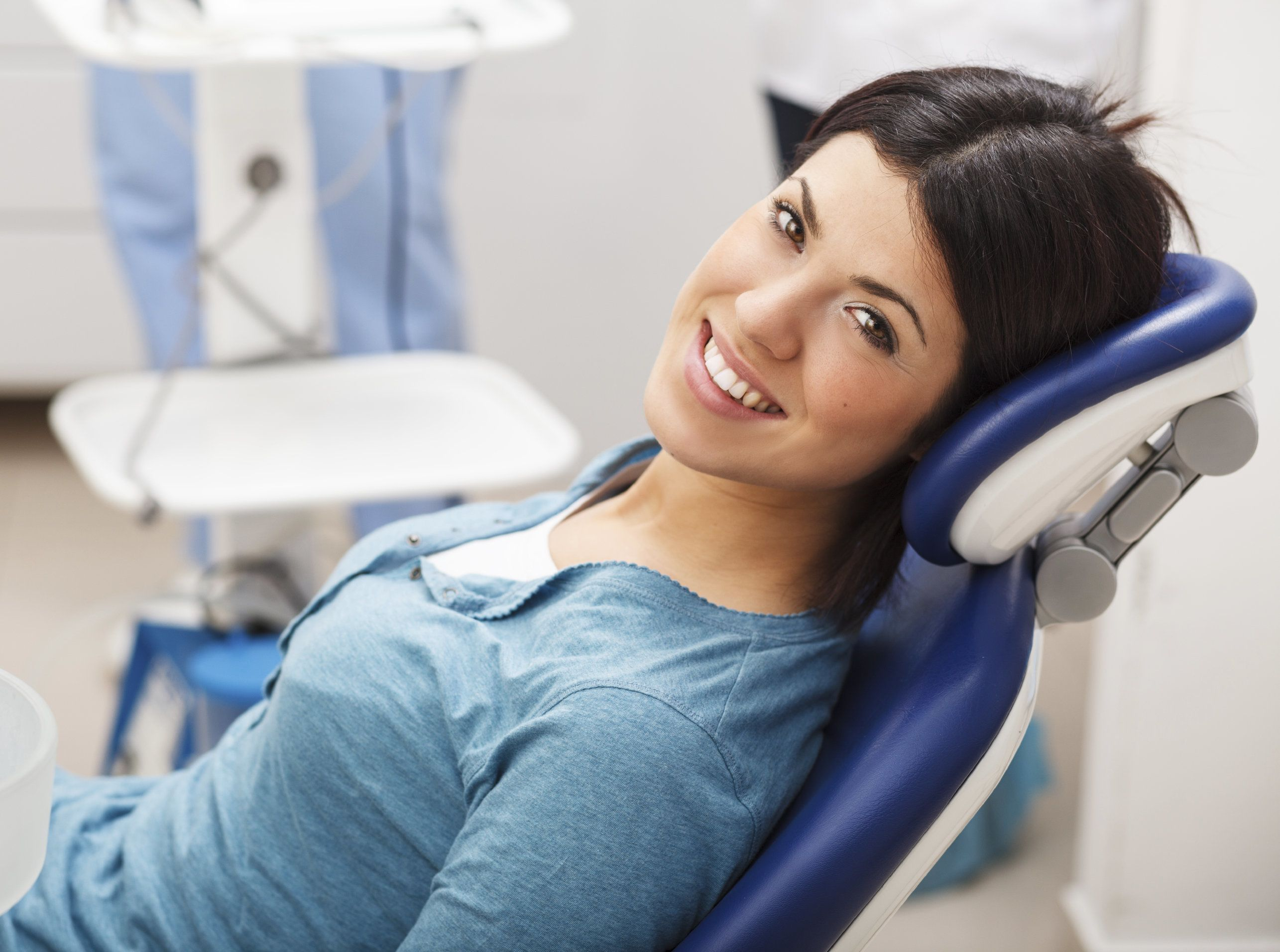 A woman with a healthy smile sitting in a dental chair