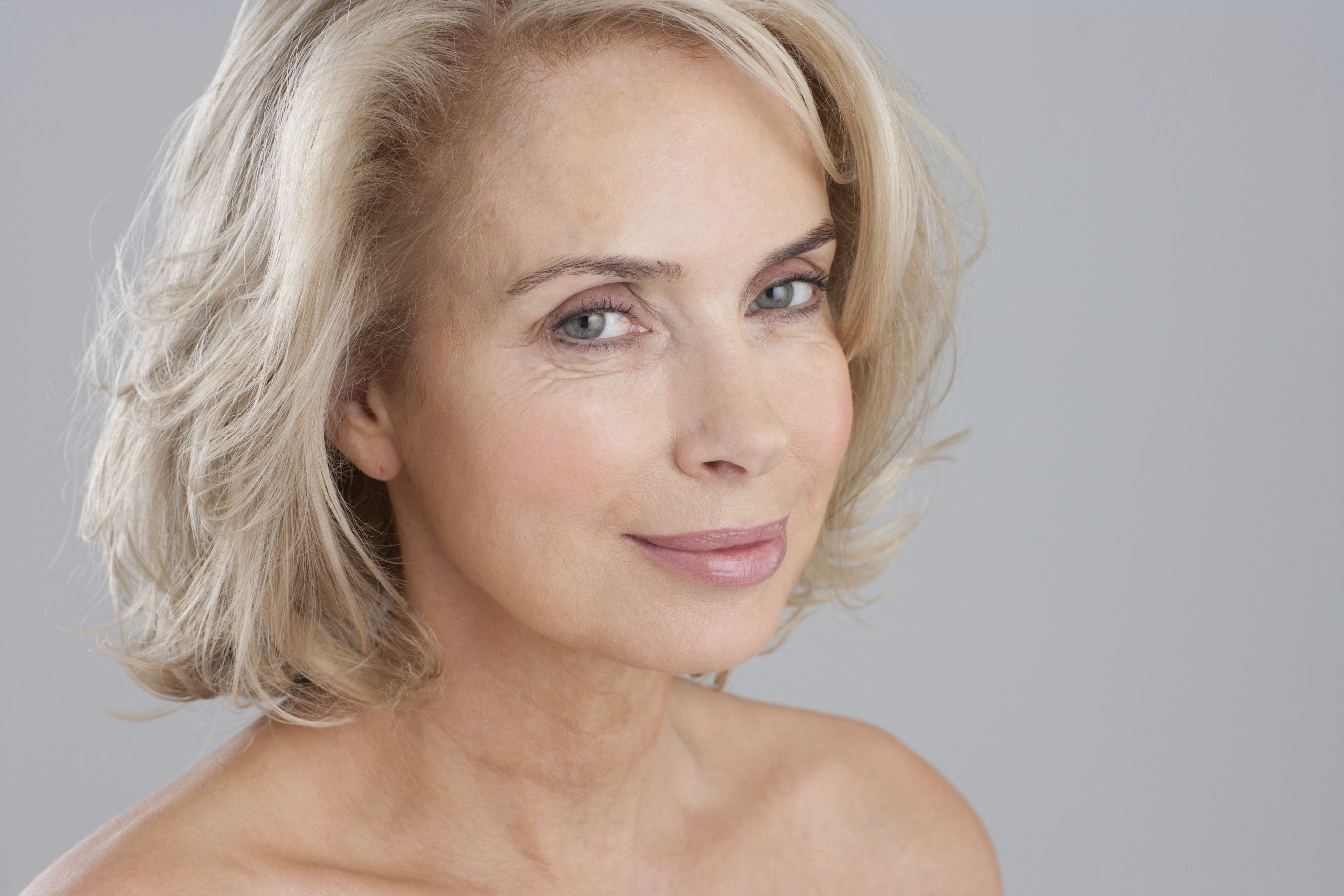 A woman in her 60s but looking much younger thanks to exquisite plastic surgery