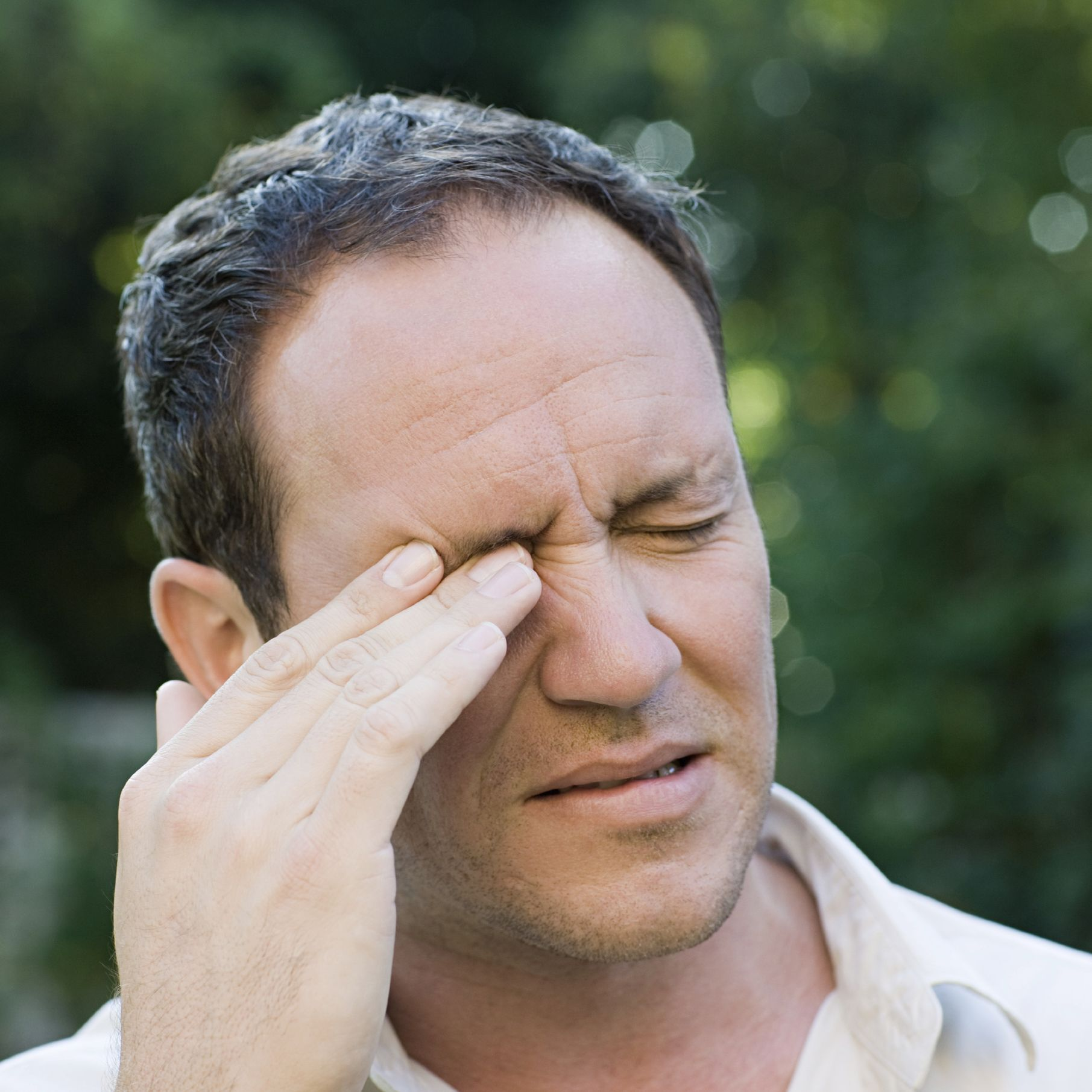 Man rubbing his eye