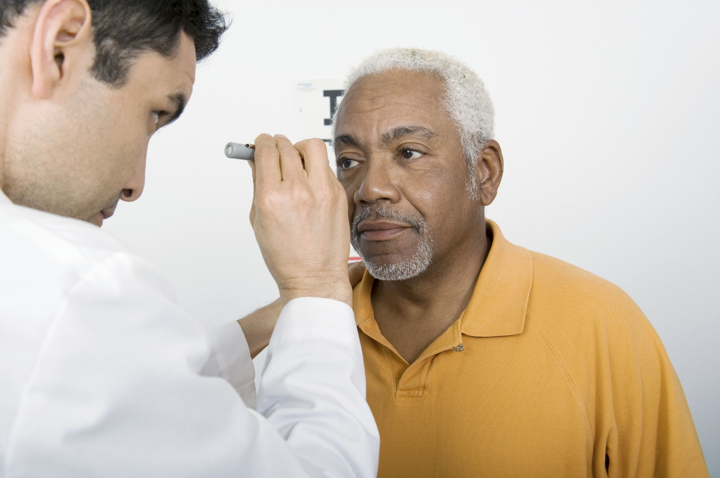 An elderly man undergoing an eye exam