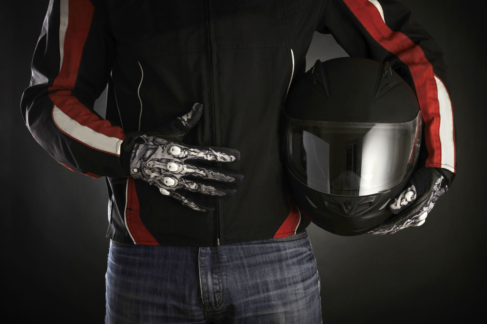 Motorcycle rider with a helmet