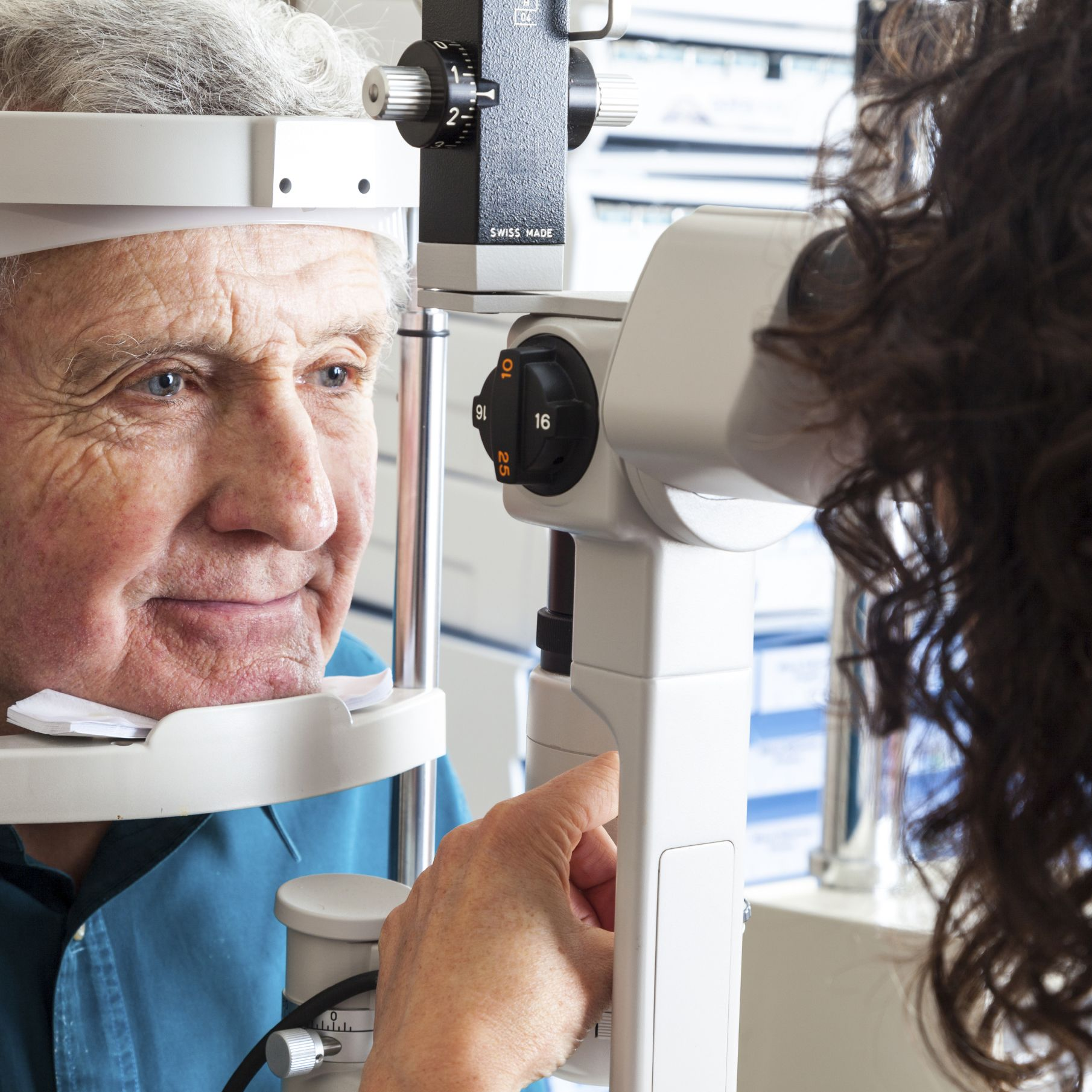 An elderly patient undergoing a cataract screening
