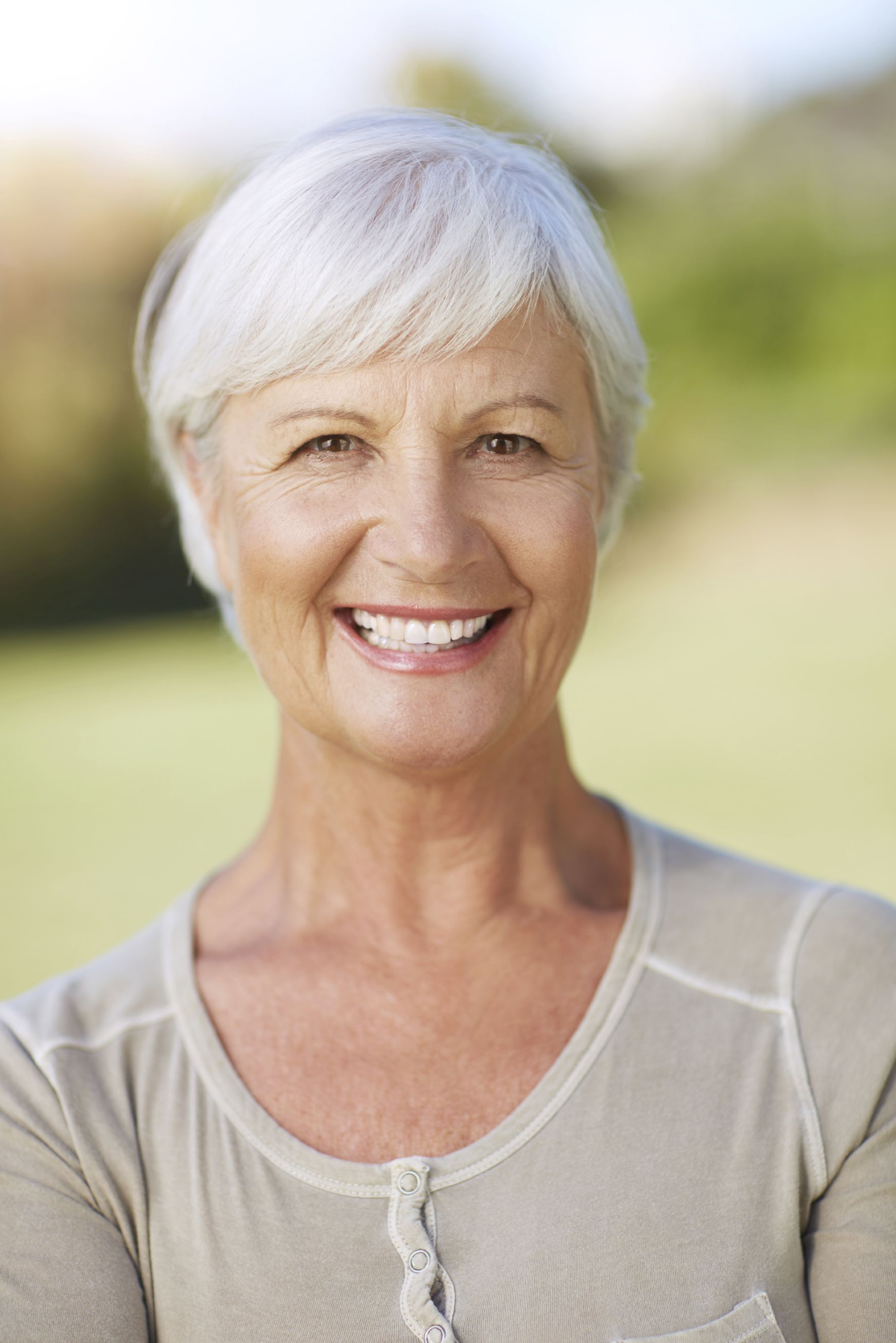 A senior woman with a healthy, vibrant smile