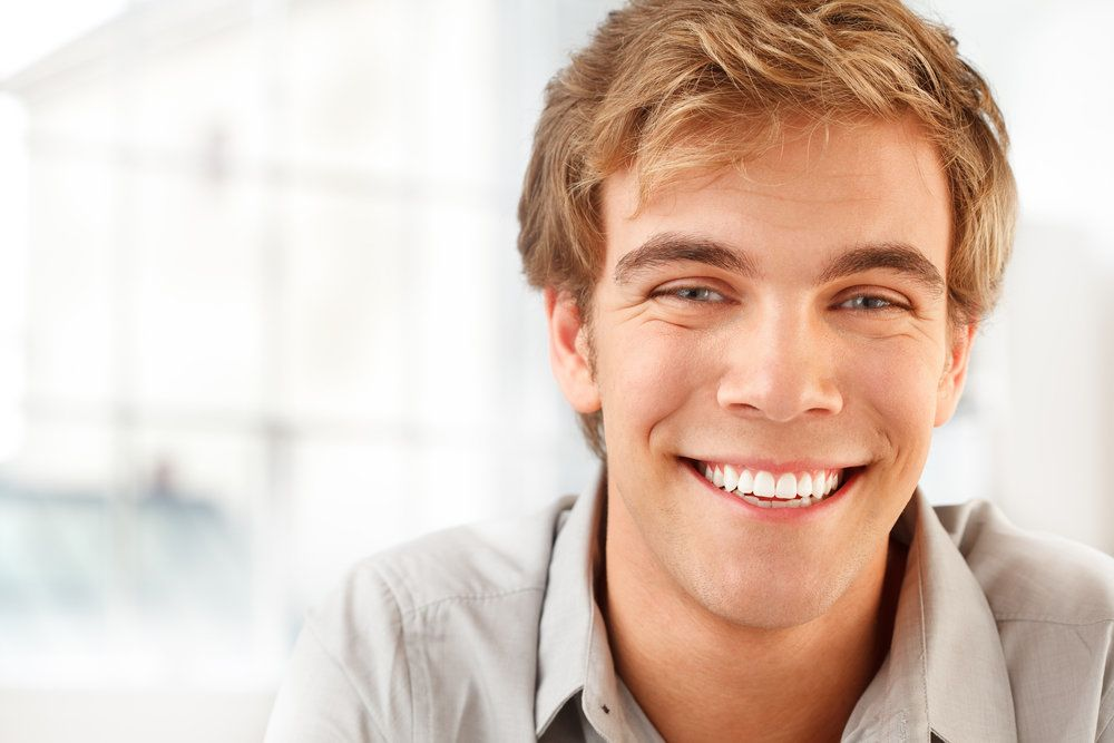 Smiling blond young man