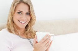 A woman enjoying a cup of coffee