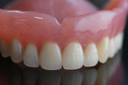 Upper full-arch denture on a table