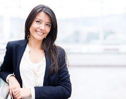 A woman in a blazer smiles
