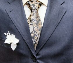 Close up of man's fashionable suit and tie