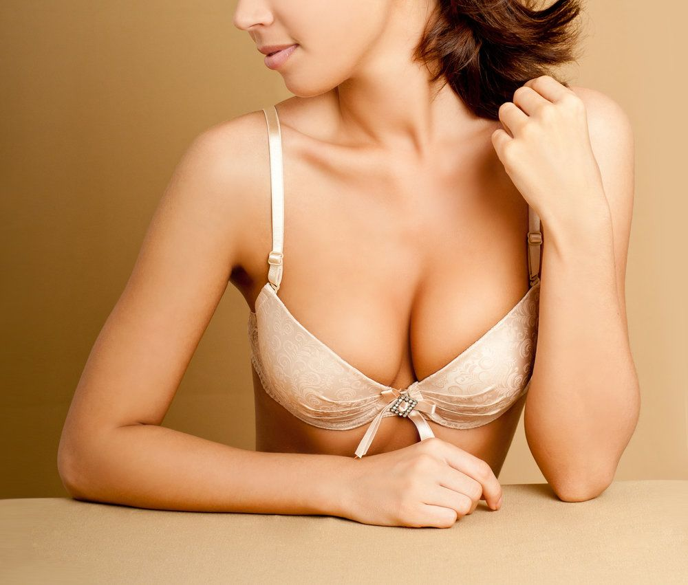 Close-up of woman's chest with beige bra