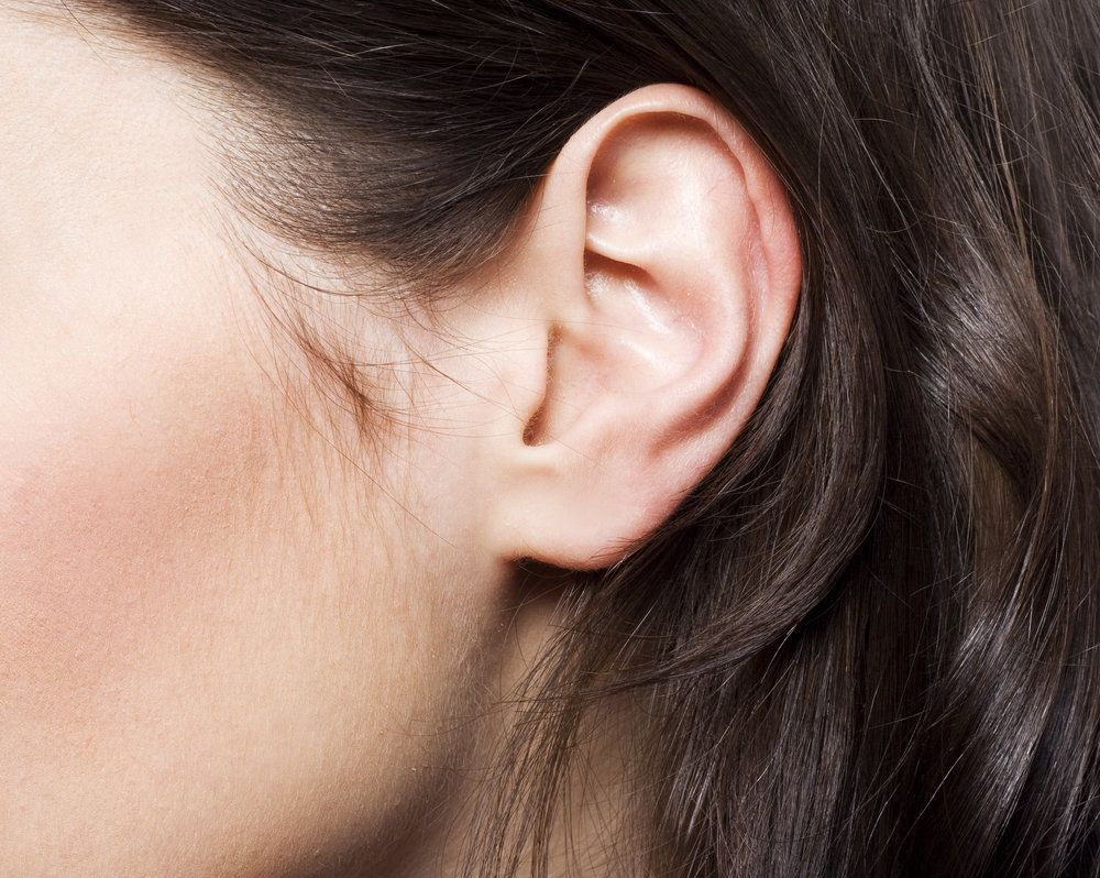 Close up of brunette woman's ear