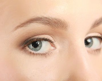 close-up of woman's face with a smooth, natural look thanks to juvéderm and restylane lyft