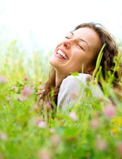 A woman smiling in a field