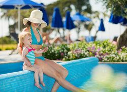 Mother with toddler at pool