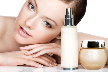 Woman with moisturizer and other skin products