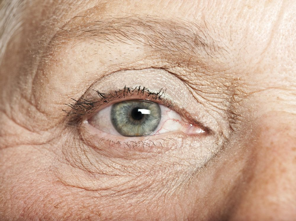 Close up elderly woman's blue eye