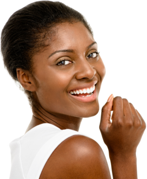 Laughing woman with hair pulled back tightly, looking back over her shoulder