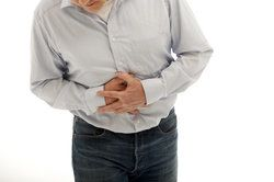 A man suffers from stomach pain