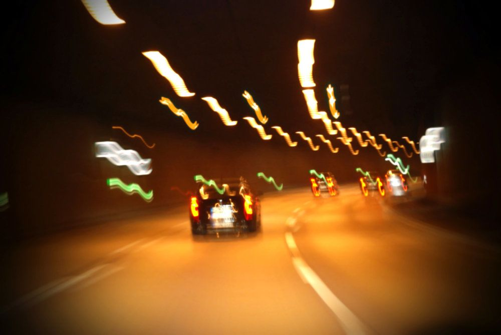 Cars driving down the road at night