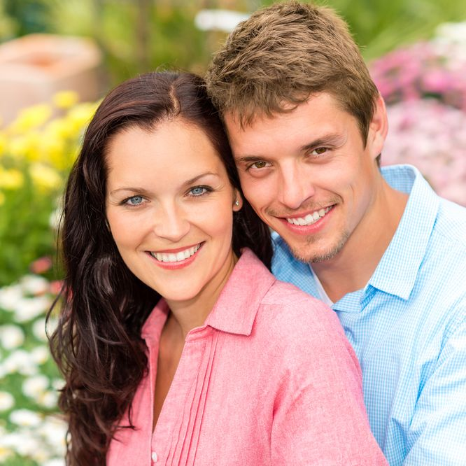 Smiling couple in a garden