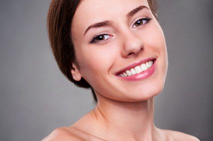 Woman smiling at the camera with perfect teeth