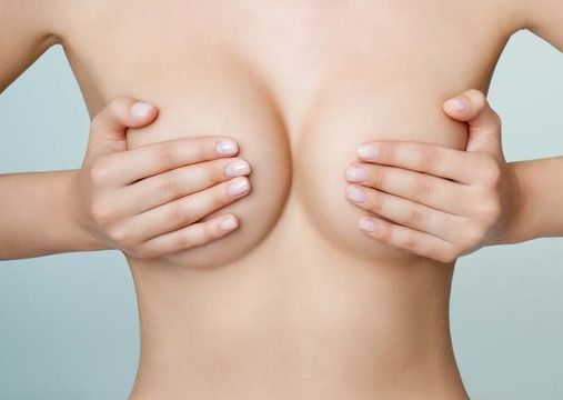 Woman pushing her breasts together.