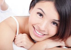 close up of beautiful young woman smiling face with healthy teeth