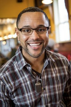 Smiling young man wearing glasses