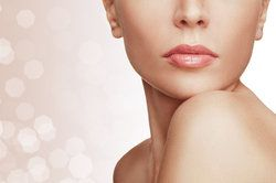 Close-up of a woman's face and shoulders - her skin glowing and youthful after treatment at The Lifestyle Center