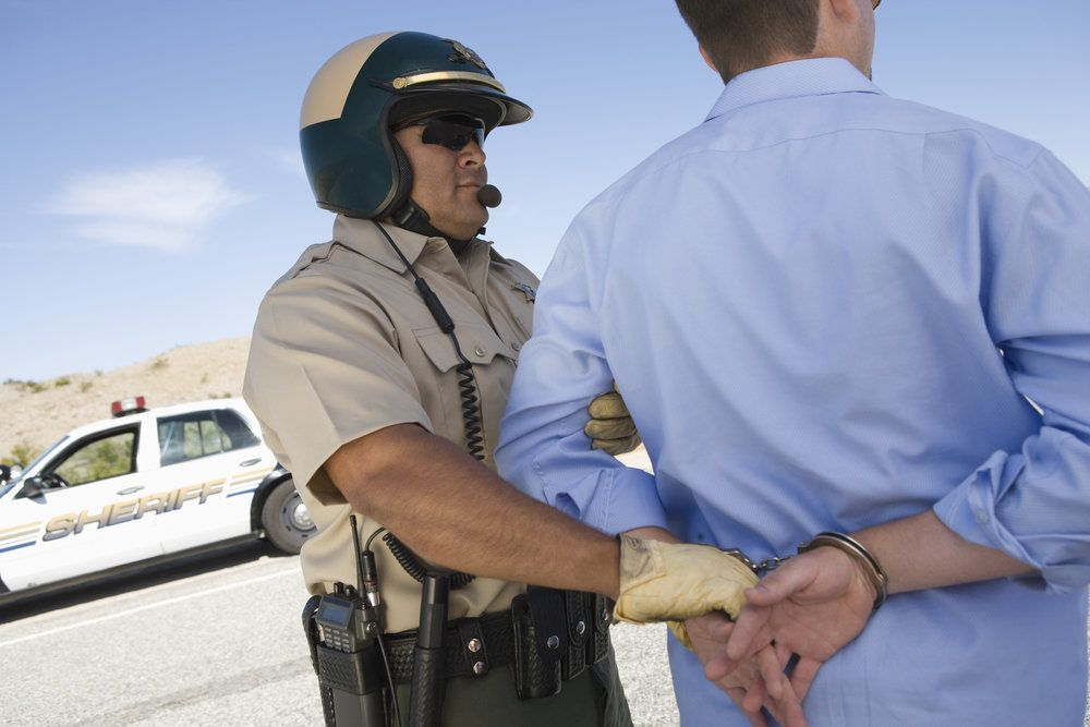 An officer arresting a driver for driving under the influence of marijuana