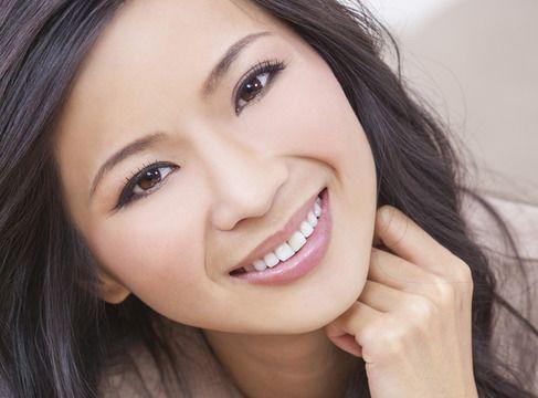 A brunette woman smiles