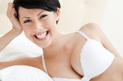 smiling woman in white bra