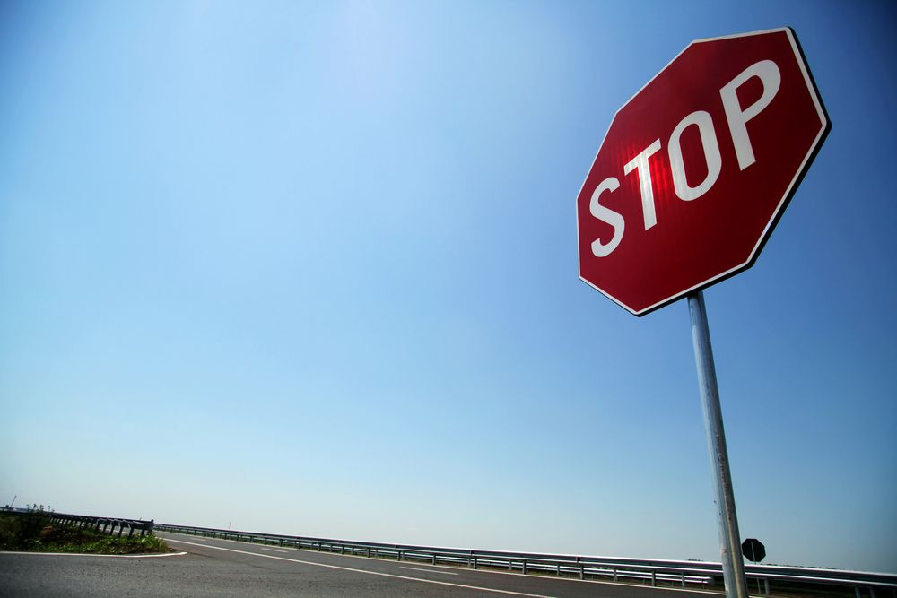 A stop sign on the road