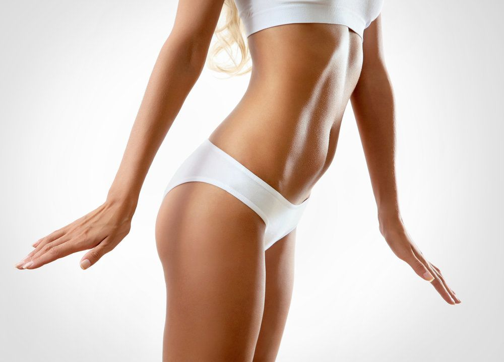 Woman's slim midsection in white