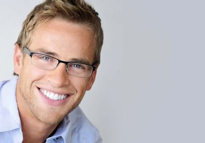 Attractive smiling man with glasses and blond hair