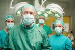 Surgical team in scrubs standing in operating room