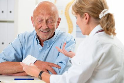 Doctor discussing treatment options with elderly patient