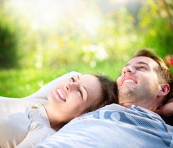 Smiling couple lying on the grass