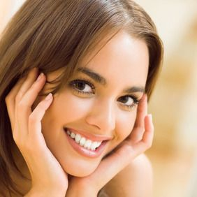 A young brunette girl with a healthy smile