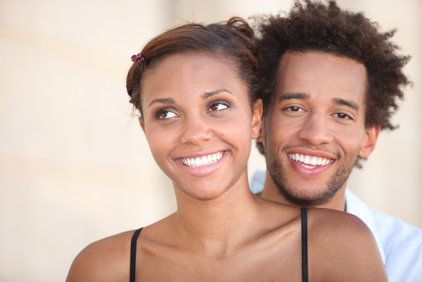 A young couple smiling.