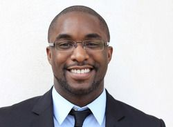 Smiling African American man wearing glasses and business suit