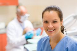 A dental assistant smiling and clearly feeling privileged to help a patient cope with a dental emergency