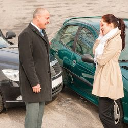 Two motorists talk after a car accident