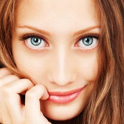 Beautiful smiling woman with bright blue eyes